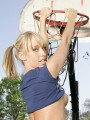 Daisy shows off her perky tits while playing basketball