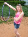 Petite teen Shelby plays around with a hoola hoop